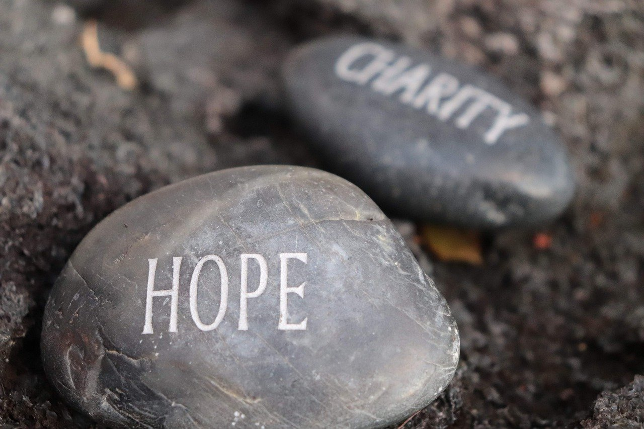 """Rocks embossed with the words """"hope"""" and """"charity"""""""
