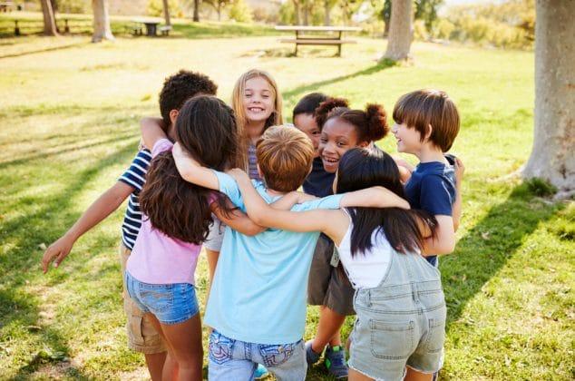 Kids' club in a huddle