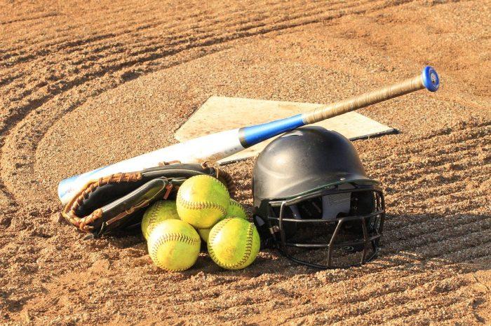Softball helmet, bat, and balls