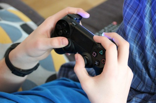 Person holding a video game controller