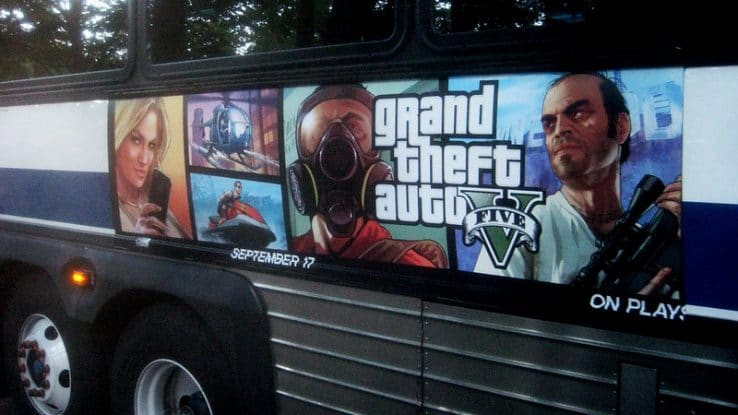 GTA V advertisement on the side of a bus
