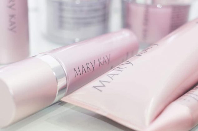 Various Mary Kay products resting on a table